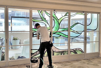 Image showing a person working on interior glass doors