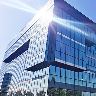 Image of a building having protective glasses covered from outside